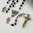 The Warrior's Rosary for Women - Black Bohemian Glass Faceted beads with Aurora Borealis effect. Crucifix and centerpiece are a two tone antique gold and silver finish  with all the Our Father medals antique silver.